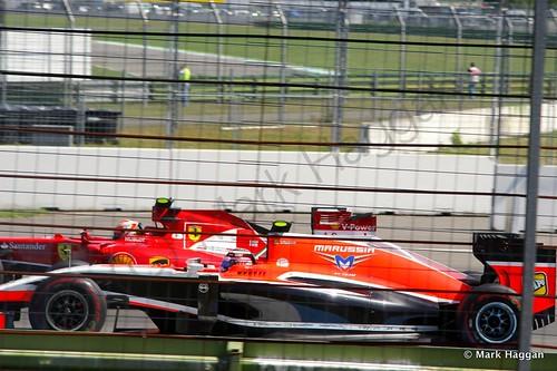 Kimi Raikkonen passes Max Chilton during Free Practice 2 at the 2014 German Grand Prix