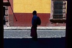 a traveller.. (camelot98.) Tags: road street leica travel light red color texture window silhouette yellow contrast mexico 50mm shadows bright candid streetphotography rangefinder sanmigueldeallende walls m9