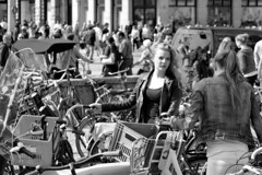 Trapped between bikes (d_t_vos) Tags: street girls summer portrait people blackandwhite bw woman sun white black netherlands girl amsterdam bike bicycle women dam crowd streetphotography bikes bicycles teen teenager youngwoman damsquare streetview facesofportraits dickvos dtvos