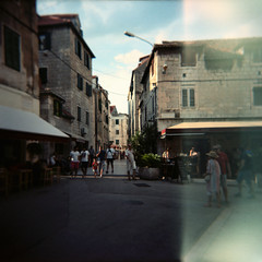 split (mathias-erhart) Tags: street city people building film buildings way person restaurant town holga croatia lightleak persons split portra160nc