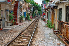 Railway line in Hanoi that runs through the city so close to shops and homes (CamelKW) Tags: city homes railway vietnam shops hanoi citycenter northernvietnam vietnam2014
