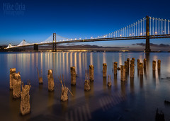 Bay Bridge (mikeSF_) Tags: california bridge blue seascape mike sunrise landscape photography dawn lights bay twilight san francisco long exposure waterfront pentax howard clear hour embarcadero pilings oria 645d pentax645d mikeoria dfa25