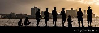 Fishermen on the seawall of Havana