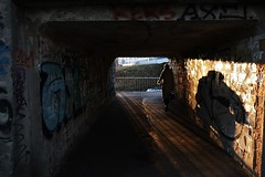Cast a giant shadow (mkorolkov) Tags: street streetphotography light shadow contrejour sunset tunnel silhouette fujifilm xe1 xf1855mm xf1855mmf284