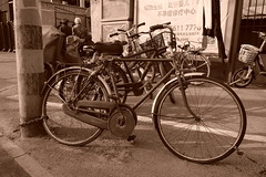 "China Beijing hutong backalley area with distressed bike - ""Wheels n Chains"" (moreska) Tags: china beijing backalley hutong bicycle onespeed distressed beatup chain transportation basic gearcover aged blackandwhite monochrome sepia retro hanja mandarin motorbike scooter pavement gritty afternoon gray capital middle kingdom asia"