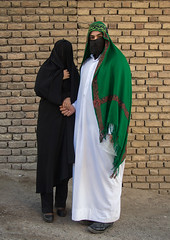 Portrait of iranian shiite muslim couple with their faces hidden by a veil mourning imam hussein on tasua during the chehel manbar ceremony one day before ashura, Lorestan province, Khorramabad, Iran (Eric Lafforgue) Tags: 20s 2people adultsonly ashura celebration ceremony clothing colorimage couple covered face fulllength hidden husband imamhussein iran islam khorramabad lookingatcamera man memorialevent middleeast mourners mourning muharram muslim mystery niqab outdoors people portrait religion religious ritual shia shiism shiite tasua tradition traditional twopeople unrecognizableperson veil vertical wife woman lorestanprovince