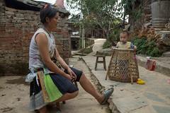 China - Basha Miao village, woman with child (lukasz.semeniuk) Tags: china bashamiaovillage woman basha miao