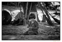 Child at play (FimRay) Tags: child children kids young youngster youngsters play beach sand girl girls asian thai thailand street traditionalstreet traditional blackandwhite bw monotone monochrome