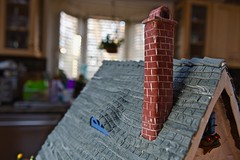 Chimney to burn the logs! (ineedathis,The older I get the more fun I have....) Tags: 2016christmas gingerbreadhouse chimney roof slateroof rooftiles modeling miniature gumpaste sugarworks baking nikond750 plants bokeh baywindow bricks royalicing whimsical old