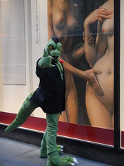 Komos at Christie's (2) (C_Oliver) Tags: usa america newyork manhattan 49thstreet christies auctioneer auctionhouse fineart window display nude nudes naked boobs tits breasts komos artslave fursuit fursuiter costume komodo komododragon lizard reptile lizardman tail mohawk goatee flower carnation medallion claws
