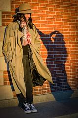 a gust of wind a comin' (vikkiq) Tags: shadow shadows brick girls teen teenagers trenchcoat wind gusty fedora hat