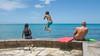 Jump (Ollie - Running on Empty) Tags: nikond7100 afsdxvrnikkor18200mmf3556gifed oliverleverittphotography hawaii oahu waikiki waikikibeach pier boys