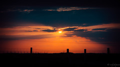 Sunset I: Descent (rickyshitpants) Tags: light sunset shadow sky people black colour silhouette death holga track fishermen sundown shingle atmosphere minimal prospectcottage ladder jacobs flotsam dying crepuscular gorse richardpitman rickyshitpants
