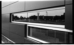 Tractricious Reflected (solarnu) Tags: bw usa chicago reflection lab hc110 f100 science scan il laboratory fermilab expired kodakplusx dilf printfilm iso64 fnal expired1998 tractricious 68f7mins