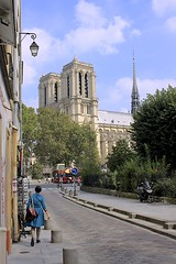 Notre-Dame Cathedral (oxfordblues84) Tags: street travel blue trees sky woman paris france building bus architecture clouds ledefrance cathedral streetlamp towers notredame spire catholicchurch notredamecathedral frenchgothic catholiccathedral westfront cathdralenotredame 5photosaday archdioceseofparis