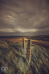 Beach Posts (ianbrodie1) Tags: cresswell posts barbed wire dunes grass windy beach sea seaside seascape cloud northumberland sand water