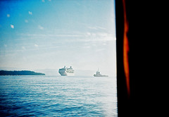 Ferry view (Stephen Dowling) Tags: 35mm film greece corfu travel summer cosinacx2 lomography agfact100precisa xpro crossprocessed