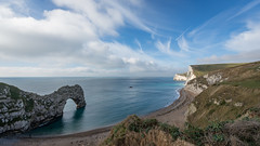 Durdle Door  Dorset (Vince O'Sullivan) Tags: europe england dorset coast landscape seascape durdledoor arch seaarch rocks sky blue clouds outdoor rock cloud