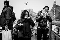 Snack Time (gwpics) Tags: female eating girl people germany mono food eat oriental streetphotography hamburg asian blackwhite blackandwhite eastern monochrome person socialcomment socialdocumentary society straenfotograpfie bw lifestyle streetpics