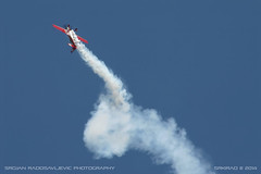 Extra EA-330SC (srkirad) Tags: aircraft airplane prop propeller extra airshow aeromiting vrac serbi srbija acro sports aerobatic silver red sky smoke trail
