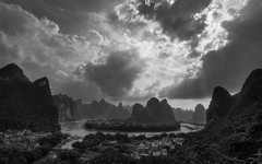 dramatic xingping (ANOTHER DAY AT THE OFFICE) Tags: xingping yangshuo li lijiang river china guangxi province adventure travel bw karst mountain clouds dramatic photography tours guide