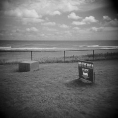 End of the World (LowerDarnley) Tags: holga pei princeedwardisland eastpoint sign fence ocean endoftheworld maritimes atlanticcanada
