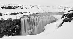 how do waterfalls camouflage themselves in winter? (lunaryuna) Tags: iceland northeasticeland landscape winter season seasonalwonders snow mist miserableweather cold waterfalll dettifoss waterfallcamouflage blackwhite bw monochrome le longexposure weathermood lunaryuna