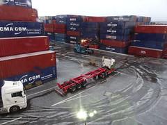 Waiting (stevenbrandist) Tags: portofliverpool container containerterminal eddiestobart trailer hail winter reachstacker