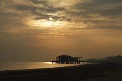 sembra il tramonto, ma non lo  - Senigallia (walterino1962) Tags: rotondaamare pontile colonneincemento spiaggia alberghi hotel mare nuvole nubi sole foschia luci ombre riflessi senigallia ancona
