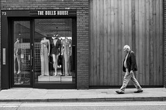 Manchester 048 (Peter.Bartlett) Tags: manchester noiretblanc walking shopfront mannequin unitedkingdom window people wall city doorway urbanarte sign peterbartlett door streetphotography lunaphoto man urban shopwindow candid uk m43 microfourthirds olympuspenf bw doubleyellowlines macphuntonality blackandwhite monochrome facade england gb