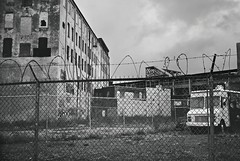 R1-74-35A (David Swift Photography Thanks for 20 million view) Tags: davidswiftphotography philadelphia kensington abandonedbuildings elevatedtrain frankfordel emptylots abandonedvehicles barbedwire fences chainlinkfence 35mm film urbandecay leicaminilux ilfordxp2
