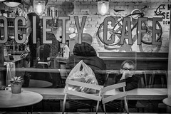 cafe boredom (Daz Smith) Tags: dazsmith canon6d bw blackwhite blackandwhite bath city streetphotography people candid canon portrait citylife thecity urban streets uk monochrome blancoynegro mono boy glasses cafe bored boredom reflections tables sat sitting