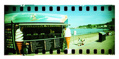 Kiosk (Pictures from the Ghost Garden) Tags: panorama color colour film 35mm toy coast seaside xpro lomography crossprocess toycamera lofi panoramic 200iso plastic 200 dorset rocket swanage plasticcamera sprocket lsi plasticlens c41 sprocketrocket