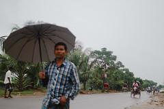 The Blurry Umbrella (Sheikh Shahriar Ahmed) Tags: road street man rain digital umbrella out season blurry focus candid streetlife waist rainy level dhaka bangladesh banasree dhakadivision sheikhshahriarahmed
