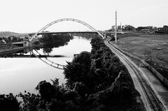 By Boat or Train (TnOlyShooter) Tags: railroad film 35mm river downtown nashville tennessee tracks om1 cumberland kodaktrix400 gatewaybridge koreanveteransbridge