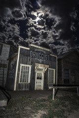 Druggist (edwham) Tags: moon newmexico santafe clouds nightscape fullmoon drugs western movies drugstore movieset prescription fillflash oldwest hallucinatory druggist elgrecosky bonanzacreekranch nocturnes090514
