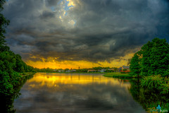 Stormy West Chase Lake (dbubis) Tags: sunset lake storm clouds tampa mirror florida odessa fl bubis dbphoto nex6