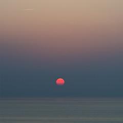 A flight to some romantic places (arkland_swe) Tags: sunset sea sun sol sweden gotland contrails snäck