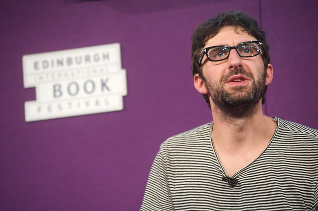 Mark Watson on stage at the Edinburgh International Book Festival