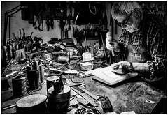 Man at work (mdmove1962) Tags: inspirational italien italy craftsman oldman workingplace work toscana move1962gmxnet michad light shadow linien strukturen pienza blackandwhite schwarzweis mann handwerk arbeit portrait