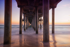 Huntington Beach Pier (Roving Vagabond) Tags: longexposure huntington beach pier under ocean water landscape color sunset rainbow sherbert socal column colonnade architechture