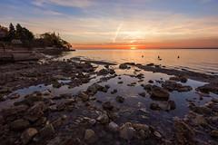 Rocky Morning Beach (cortreithofer) Tags: sunrise burlington canada ontario sky colour wideangle lake water pools banks beach beautiful