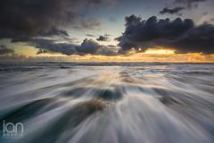 Wet Wellies (ianbrodie1) Tags: druridge bay northumberland nikon d750 water sea seaside seascape cloudsstormssunsetssunrises sunrise cloud rocks swirl rush outdoors cold coast coastline