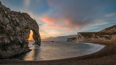 Through the arch (Wizmatt) Tags: hdr durdle door dorset geology coast sunset golden yellow sea water rocks arch natural beach bats head landscape british canon70d sunspot