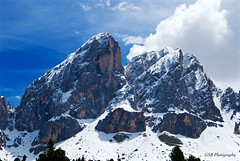 Peitlerkofel, viewed from Würzjoch Pass, Dolomites, South Tyrol, Italy (GSB Photography) Tags: italy dolomites peitlerkofel peitlerkofelgruppe mountains peaks mountain greaterdolomitesroad serene serenity clouds nikon d60 snow ice sunshine rocks rugged bluesky sky nature gsb