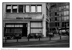 Wings (Spotmatix) Tags: brussels streetphotography vignette camera canon effects film monochrome polypanf prima