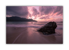 A Malaysian Sunset... (EXPLORED #86 20th Nov, 2016) (HotSnapshot) Tags: sunset sunsets beach sea rock boulder clouds cloudmovement purple pink malaysia langkawi andaman theandaman theandamanlangkawi border borders longexposure longexposures canon 1635mm 1635f4 canon1635mmf4 5d canon5dmark3 canon5dmarkiii sun explore explored