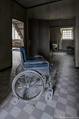 The worst thing about a disability is that people see it before they see you.. (Kristel van de Laar Photography) Tags: abandoned decay belgium urbex indoor window hospital photography sanitarium sadness sickness darkness lonelyness mental mansion wheelchair