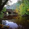 Autumn Bridge - Velvia 100 exp* (magnus.joensson) Tags: sweden swedish skåne naturreservat rövarekulan hasselblad 500cm zeiss distagon 50mm cf fle fuji velvia 100 exp2007 polarizer 81a e6