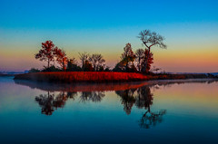 An island at sunrise.... (tomk630) Tags: virginia nature colors light water island sunrise usa reflections peaceful trees